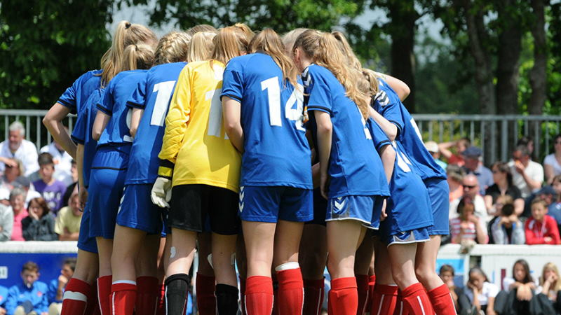 Female football huddle